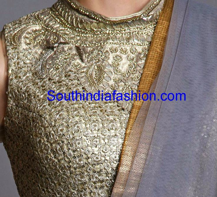 Embellished closed neck gold saree blouse with net sleeves and show buttons on the back. Related PostsHigh Neck Blouse with Net BackHigh Neck BlouseClassy High Neck Blouse Designs: 10 Trendy PatternsHigh Neck Blouse with Button Placket