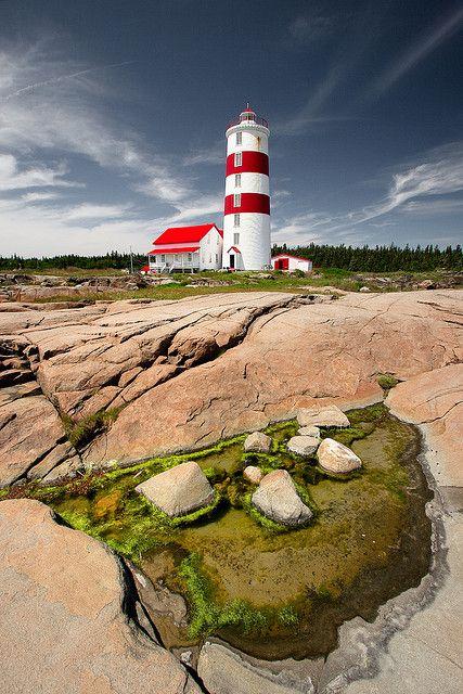 Lighthouse, Pointe-des-Monts, (northern) Quebec, Canada.  Photo: Luc Rousseau