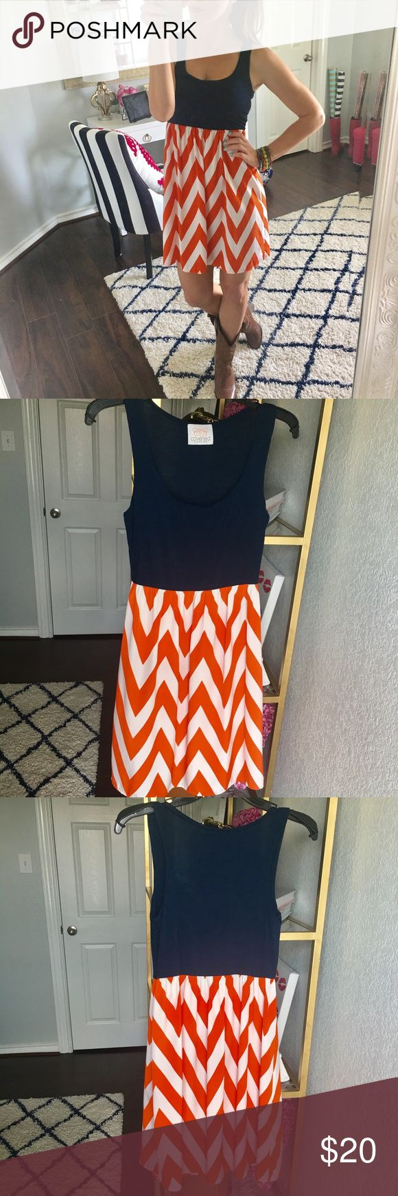 Navy and Orange Chevron Dress This eye-catching dress is very comfortable! Navy contrast is made of 94% Viscose and 6% Spandex and bottom is 100% Polyester // Worn once to a football game // No trades, please 💋 Coveted Clothing  Dresses