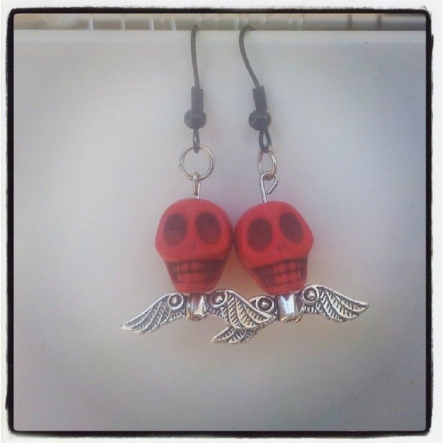 Red Skull and Silver Wings Earrings $7 Aust. From Rags To Bags on FaceBook.