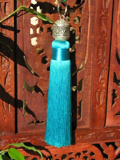 Moroccan silver and silk tassel in turquoise. http://www.maroque.co.uk/showitem.aspx?id=ENT02783&p=01571&n=all