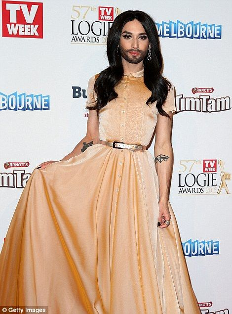 Beige bliss: Conchita Wurst had heads turning in this number secured with a gold waist bel...