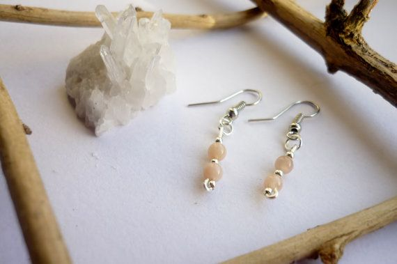 This is a tiny, very delicate and romantic style pair of earrings.  Moonstone is a stone of calm and relief from emotional stress. It is also associated with love of all kinds. It brings hope, enhances feminine energies, sensitivity, intuition, and psychic abilities.  These earrings come in a brown envelope which reminds of nature's simplicity, along with a personal message for you.