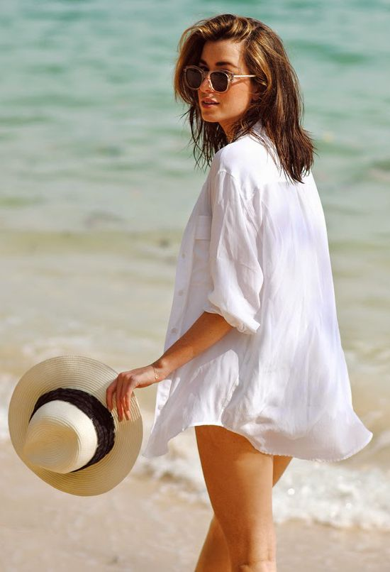 Carmen Hamilton is wearing a white boyfriend shirt from Equipment and a hat from Eugenia Kim