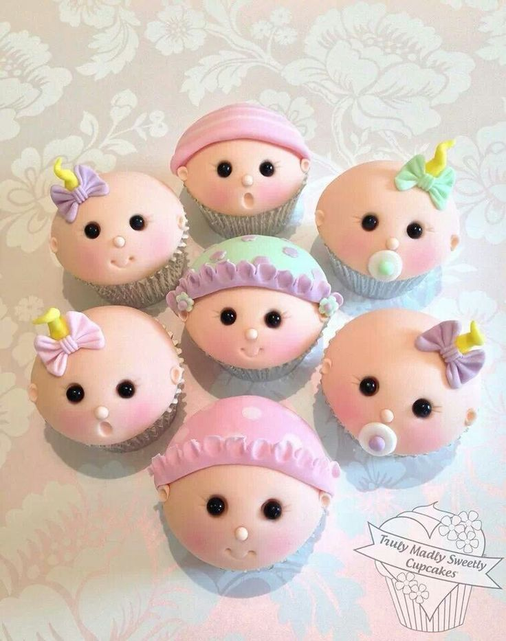 Baby Shower Bliss - Baby face cupcakes via Family Holiday. (Inspiration)