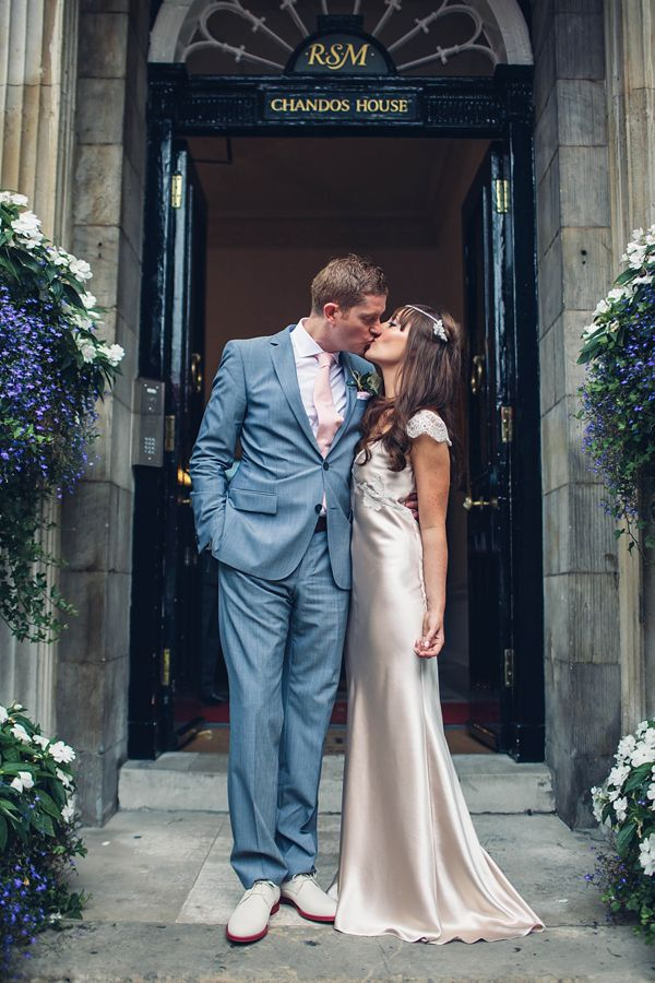 Sarah and Julian on the Chandos House front steps.  Taken by Caro Hutchings for their 'Bright Lights Big City' Inspired Wedding.