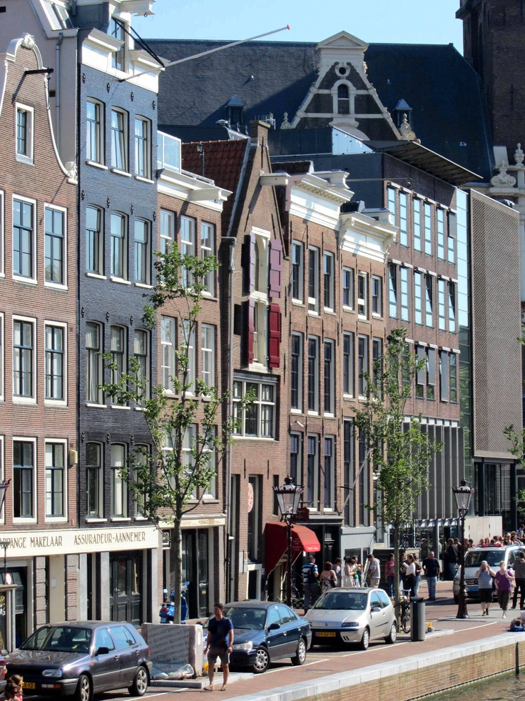 Anne Frank Huis (Anne Frank house, the house right next to the house with the red shutters) located on the Prinsengracht canal in Amsterdam.