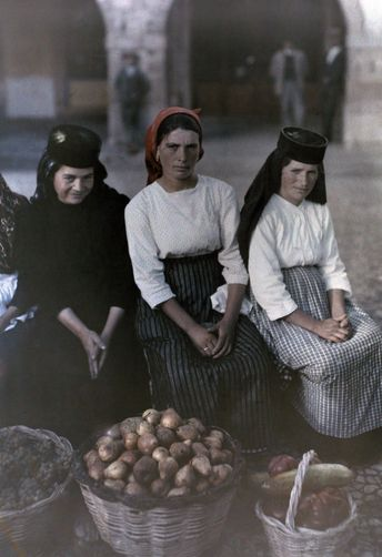 Picture Id: 941438 Three portuguese women pose with their baskets of goods at the market. Location: Portugal. Photographer: GERVAIS COURTELLEMONT/National Geographic Stock