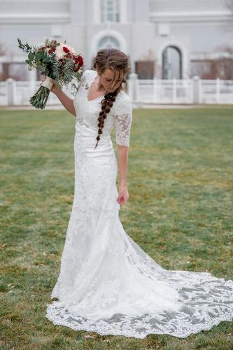 Im selling my wedding dress. Im 5'8 and the dress is a size eight, possibly a six(I had it fitted). It has Quarter-length sleeves. I bought it for over $1000. Its practically brand new. I wore it for bridals and my wedding day. I wish I had a picture of the back! Its buttoned (you dont actually have to button it. It has a zipper)all the way to the lower back. Feel free to email me if you have any questions! kikismoss@yahoo.com