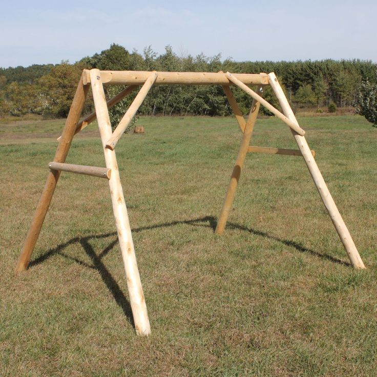 "Features:  -Strong and durable.  -Northern white cedar is naturally rot resistant..  -Made in the USA.  -Pre-drilled holes in the top rail where the swing will hang from are 66"" apart.  -Material: Woo"