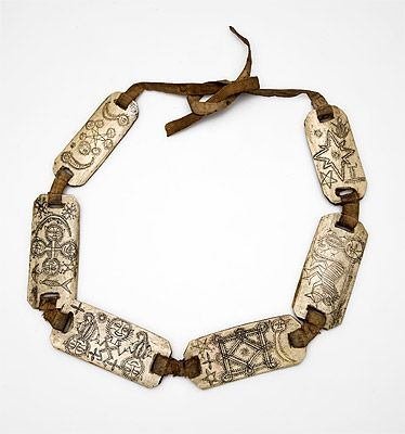 Indonesia ~ North Sumatra | String of amulets from the Toba Batak or Karo Batak people | 19th/early 20th century | Bone and cotton | *This string of amulets inscribed with symbols and magic inscriptions is typical of the protective charms worn by priests when undertaking dangerous sorcery.