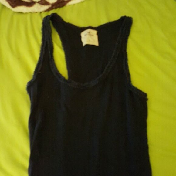 Hollister tank! Navy blue with ruffles on the top.  No issues at all, never worn! Can sell cheaper on mer! Hollister Tops Tank Tops