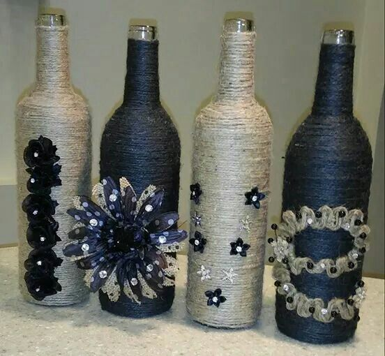 Wine bottles wrapped in twine or yarn and add acessories