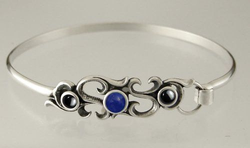 Sterling Silver Victorian Inspired Strap Bracelet with Genuine Lapis Lazuli Accented with Hematite The Silver Dragon- Bracelets. $63.00. Designed And Hand- Crafted in Sterling Silver; The Silver Dragon uses Sterling Silver that has been Reclaimed... Helping Save Mother Earth's Resources.; This Unique Bracelet is Created only after Your Order Arrives. Please Allow 7-10 days for Delivery.; This Bracelet Fits a Standard Woman's Wrist; This Bracelet was Designed by Th...