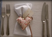 Pink hearts - special touch but just is pretty!  Need about 60 napkins in either White / Cream.  Very happy to wash and iron for you on return.
