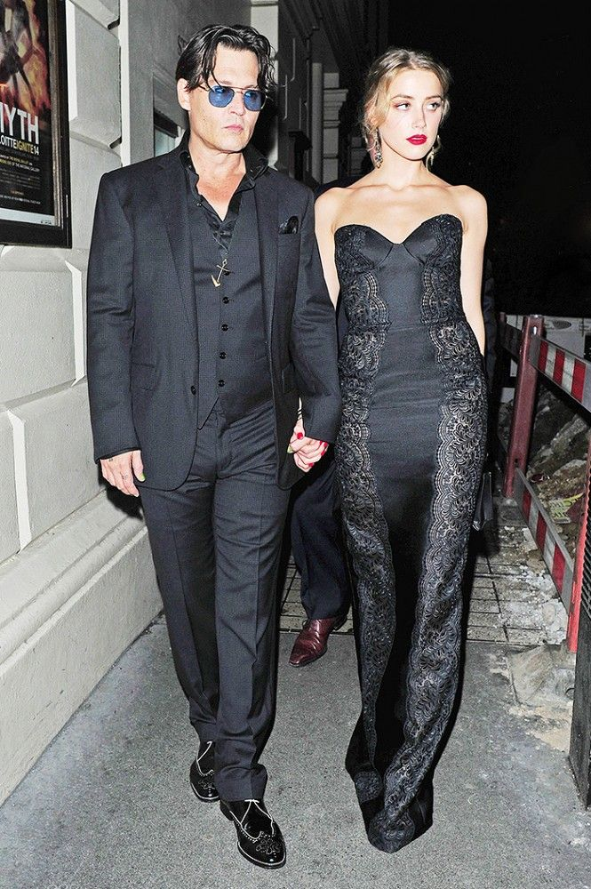 Johnny Depp and Amber Heard both in head-to-toe-black.