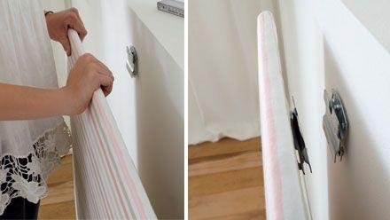 mit Stoff bezogene Spanplatte an der Wand anbringen