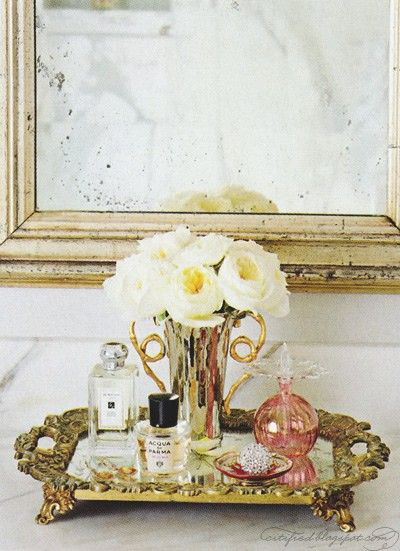 i'm dying for an antique, mirrored tray to hold my perfumes.   so classically elegant.