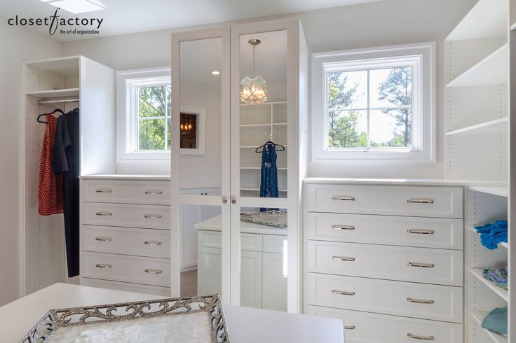 Build around bedroom windows to maximize every square inch of closet space, like in this elegant white melamine walk-in.  Learn more: