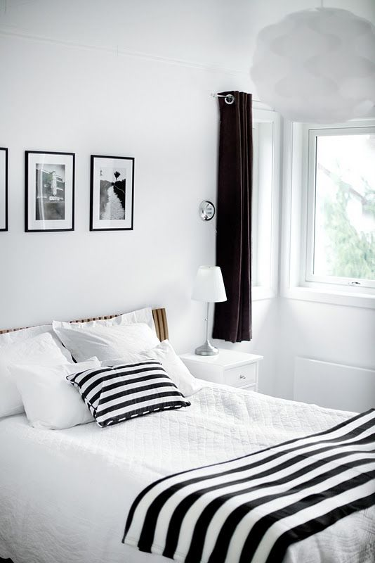 Love the stark black and white contrast. Clean, modern, yet still inviting enough to sleep in.