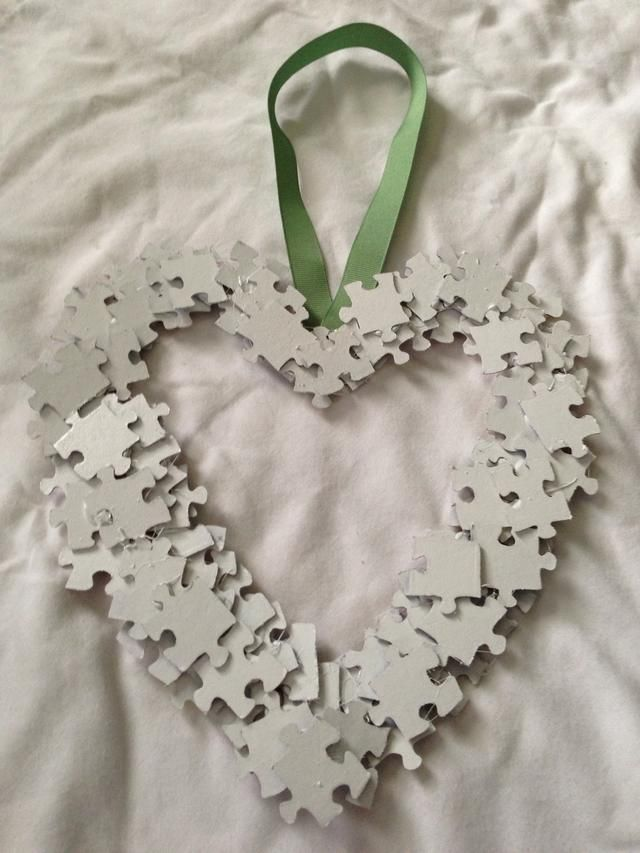 Once the heart is formed then spray with paint.  I used white paint and because I bought cheap spray paint I needed 2 coats. Dry before adding a second coat.   Add ribbon to back with a glue dot.