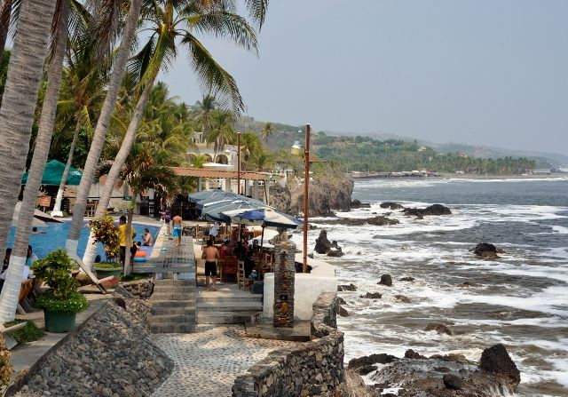 La Curva de Don Gere Restaurant, La Libertad, El Salvador. Great food and fabulous views make up for rough seas and the rocky shore at this popular destination for day-trippers from the capital.