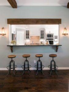Diese grauen und braunen Küche bietet komplizierte Designs durch Metall Hocker und Holzsitz aber folgen dem Prinzip des Minimalismus.