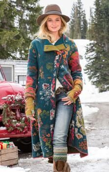 You'll enjoy facing the elements wrapped in the embracing warmth of our chic embroidered wool blend coat.