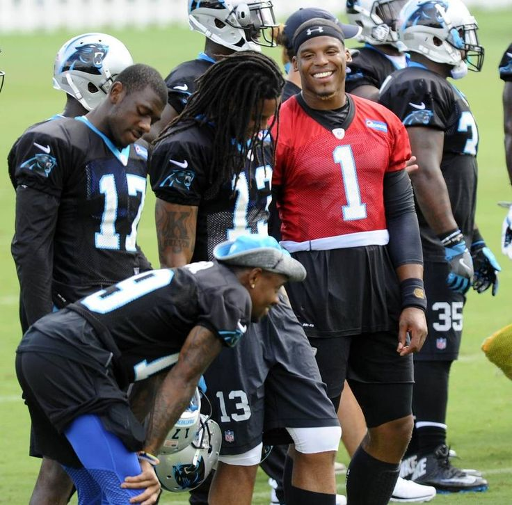 Carolina Panthers quarterback Cam Newton (1) talks with wide receivers Kelvin Benjamin (13), Devin Funchess (17), and Ted…