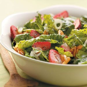 Strawberry Salad with Poppy Seed Dressing - My neighbor brought this over last night to our Fourth of July barbecue and it was fabulous! EVERYONE wanted the recipe and we emptied the bowl.  You candy the almonds and the dressing recipe is included.  Sooooo Good.  I HIGHLY recommend this!