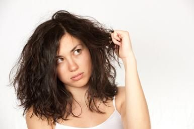 Woman with dry, frizzy hair. - tderden/ E+/ Getty Images
