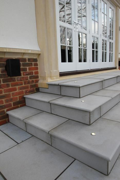 Contemporary Grey Sandstone step treads can be coupled with identical coping stones and paving for a consistent colouring and characteristics throughout your garden design.