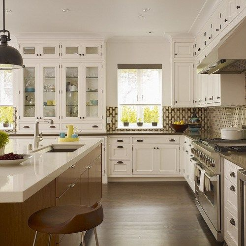 """Kitchen Trash Can Cabinet Home Design Ideas, Pictures, Remodel and Decor #kitchen #refacing http://kitchen.remmont.com/kitchen-trash-can-cabinet-home-design-ideas-pictures-remodel-and-decor-kitchen-refacing/  #kitchen trash can # Kitchen Trash Can Cabinet Home Design Photos Photos by Rob Karosis AFTER: A custom island replaced the existing one; it includes a trash center with storage drawers on one side and storage cabinets. tray storage and a built-in recessed wine rack on the other. """"We…"""