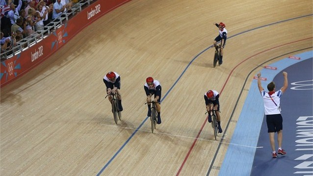Edward Clancy, Geraint Thomas, Steven Burke and Peter Kennaugh of Great Britain celebrate after winning gold and setting a new world record in the Men's Team Pursuit Track Cycling final on Day 7 of the London 2012 Olympic Games at Velodrome