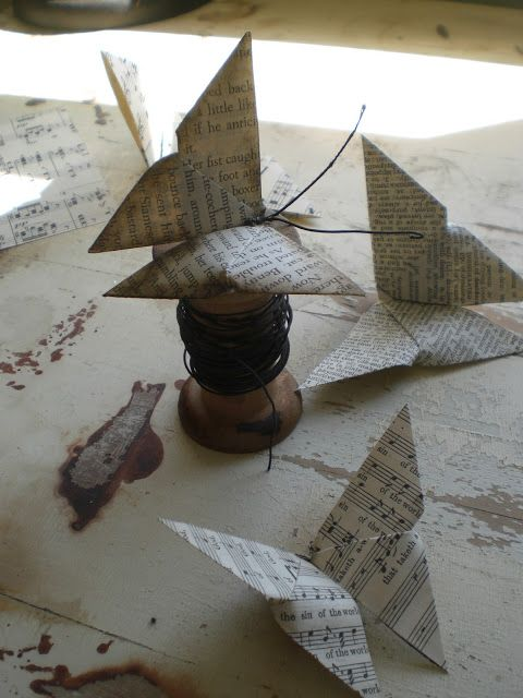 Origami butterflies made from old book pages.