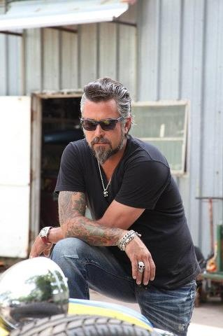 Fast 'n Loud....this guy isn't hard on the eyes either! LOL