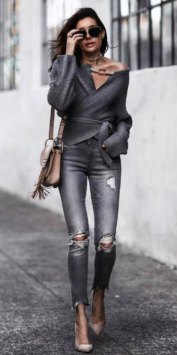 Erica Hoida + wrap-front cardigan + tied around the waist + accentuate her silhouette + skinny + distressed jeans + chunky jewellery + stilettos + Spring style. Brands not specified.