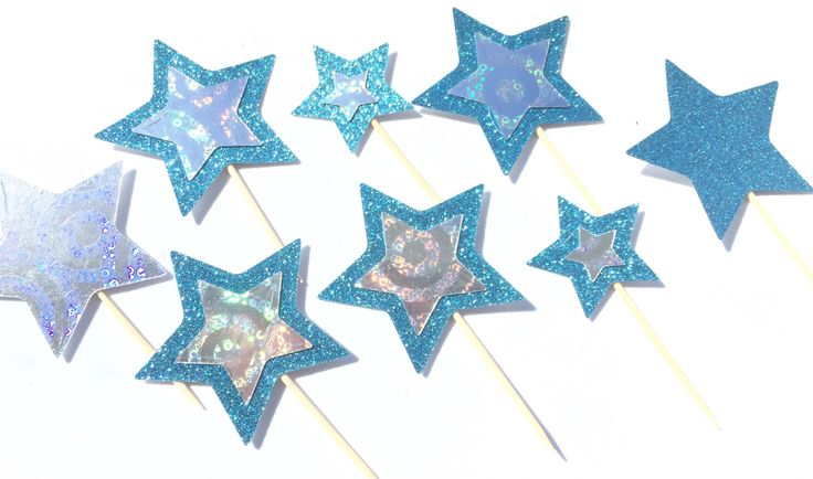 A personal favourite from my Etsy shop https://www.etsy.com/uk/listing/526615390/blue-and-silver-star-cake-toppers