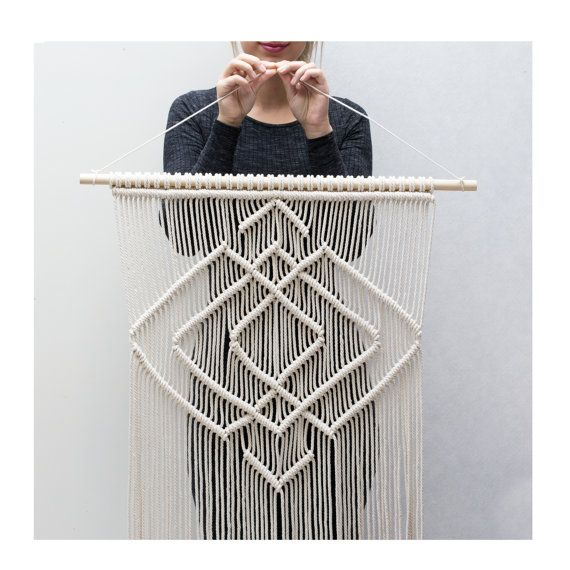 With this beautiful modern geometric styled wall hanging, youll add a real eye catcher to your space!  This Macrame wall hanging is handmade with neutral twisted cotton macrame cord.   -----------------------------------  This macrame wall hanging measures:  Wooden dowel length- 72cm ( 28.5 inches ) Macrame length- 110cm ( 43.5 inches )   This item is finished and ready for shipment.  => View other Macrame Wall Hangings here: www.etsy.com/shop/TeddyandWool  You're always welcome to contact…