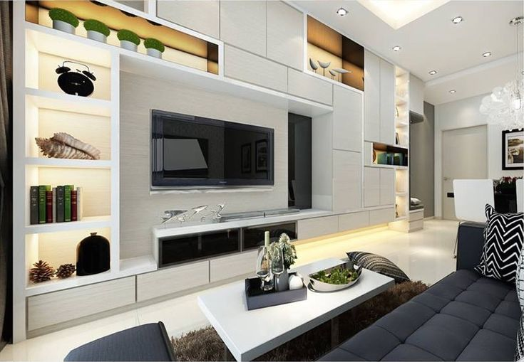 From the moment you step into the apartment, you notice the signature design element, which is the TV feature wall.