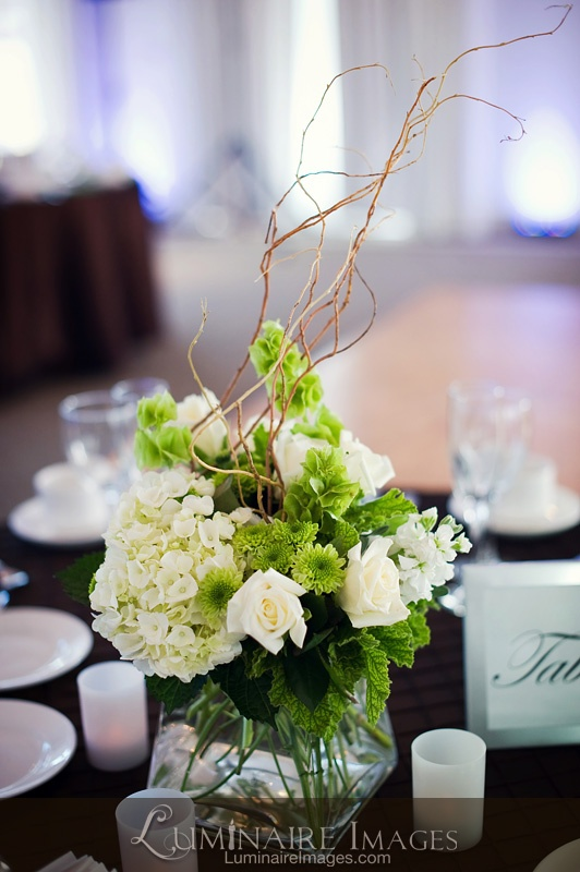 Green and white floral centerpiece black tablecloth