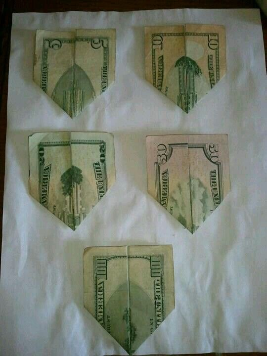 5 dollar bill folded shows twin towers, 10 shows planes collide, 20 shows buildings falling, 50 shows cloud of smoke, 100 shows new beginning, and all are folded in the shape of an airplane. So weird