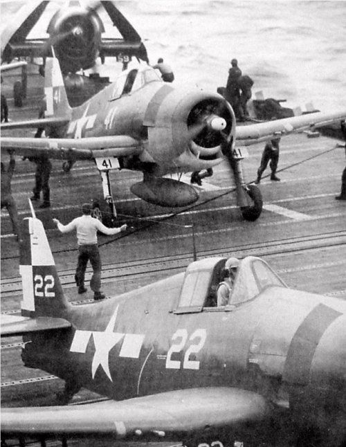 F6F Hellcats on board USS Hornet (CV-12), late January 1945, during strikes against Formosa. The flat windscreen Hellcat, the one closer to the camera, is an F6F-5; the round windscreen one is an F6F-3. Both aircraft belonged to VF-11.