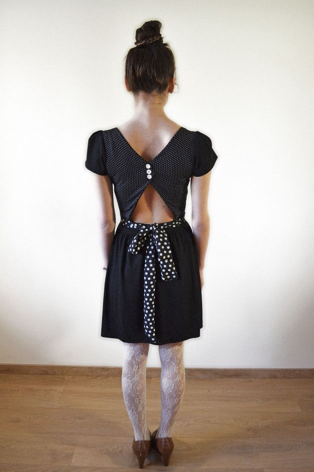 Open Back dress with playful details..