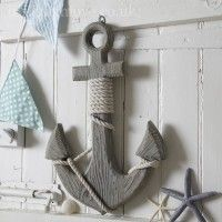 Giant wooden wall hanging anchor which has twisted rope detail around the edge. The anchor colour is grey with rustic distressed wood. Strong wall hanging fixing on reverse. Will look good in a nautical themed room.