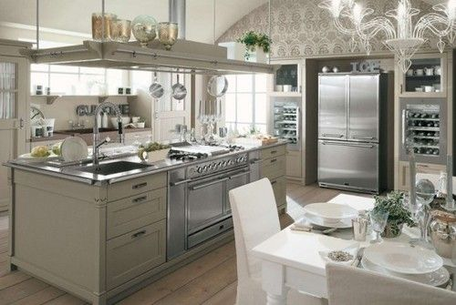 Todays' kitchen porn is quite upmarket - I expect a spinach styled soup and then a vanilla based dessert :) What do you want to eat out of this kitchen. And I LOVE THE wine racks at the back :)