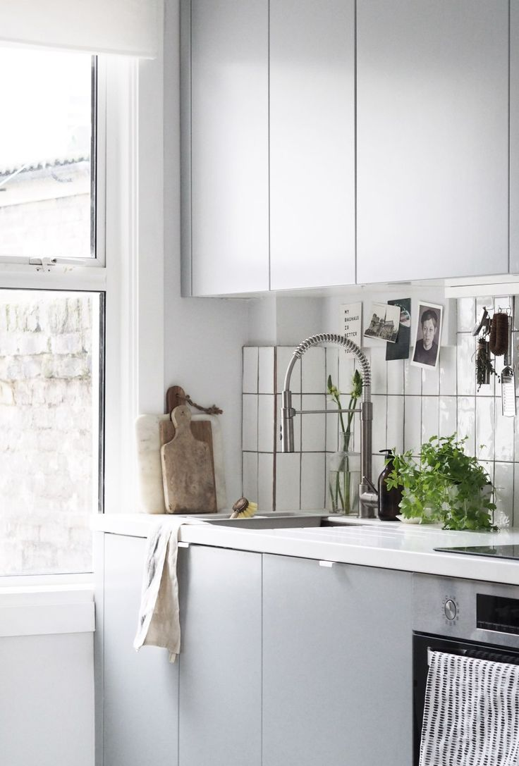 IKEA VEDDINGE minimal grey doors and white metro tiles create a calm, relaxed kitchen,