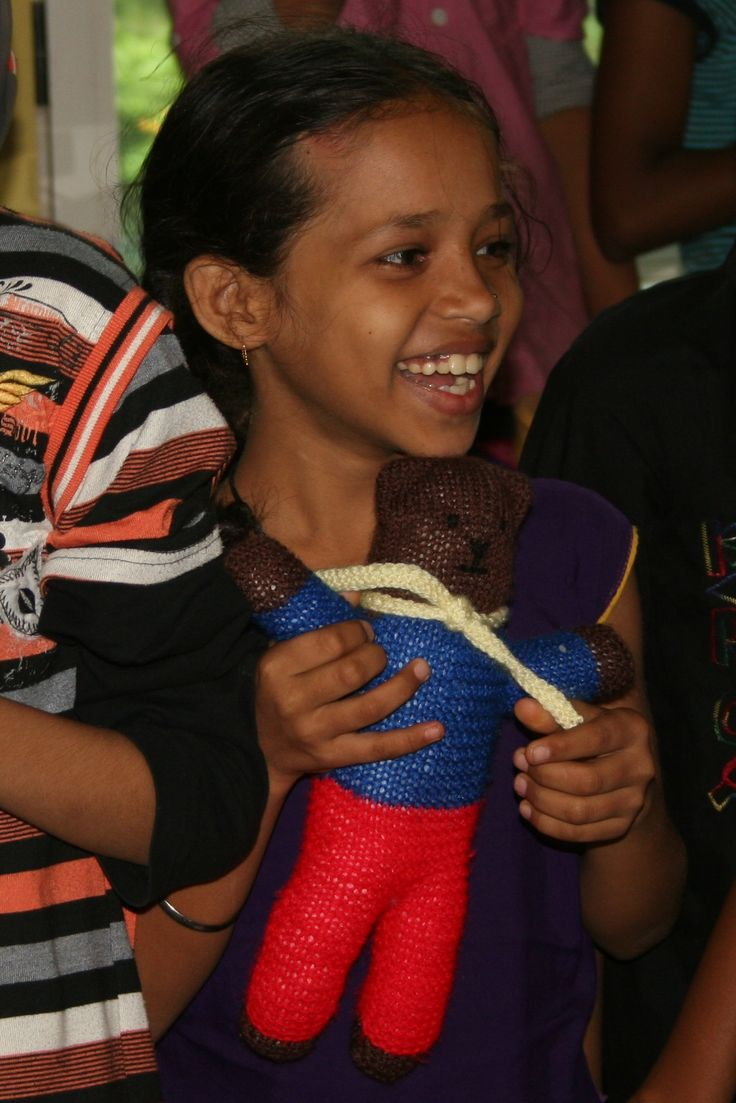 Snakes On A Plane Bathroom Girl - A little girl from the mumbai slums with her new handknitted teddy bear from teddies for