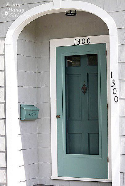 The color of the exterior screen door matches the front door color.