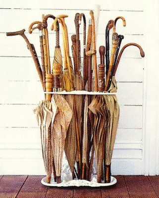 vintage umbrellas - chic ways to face a rainy day. Also the walking stick collection!